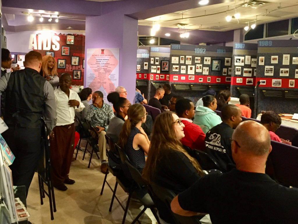 Audience gathers at start of event Impact of HIV Stigma on the Black Community in South Florida at the World AIDS Museum and Educational Center 10-24-2017