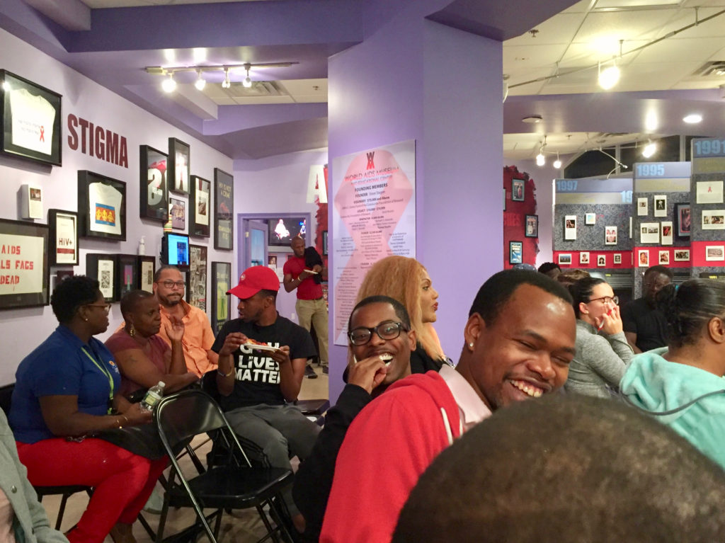 Community attendees relax attending the Impact of HIV Stigma on the Black Community in South Florida event at the World AIDS Museum and Educational Center 10-24-2017.jpg