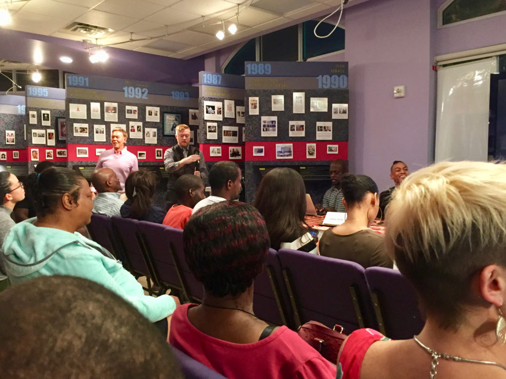 Community members anticipate start of Impact of HIV Stigma on the Black Community in South Florida event at the World AIDS Museum and Educational Center 10-24-2017