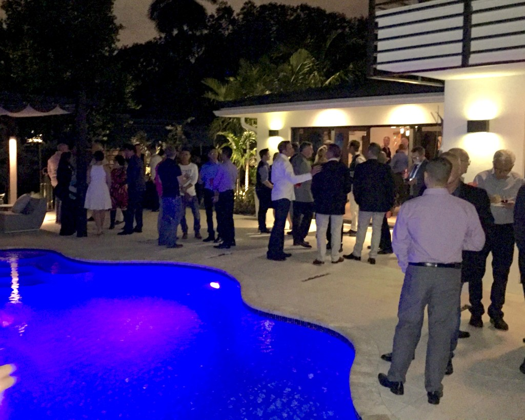 world aids museum fundraiser guests night-lit pool